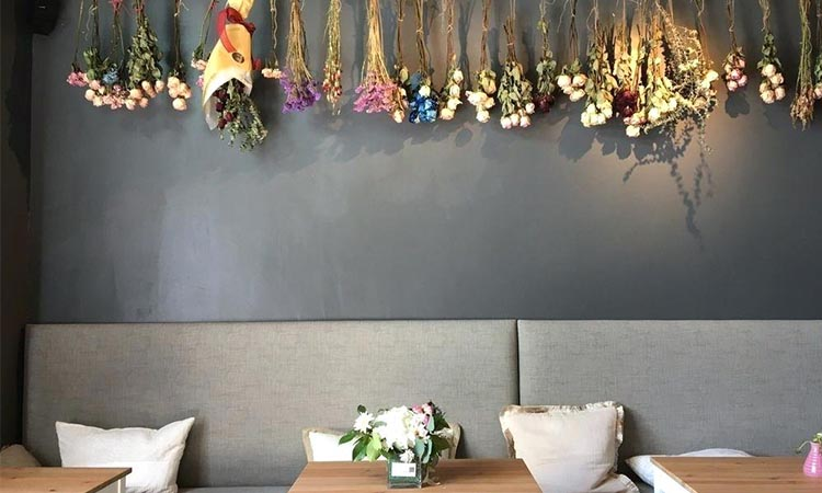 Flower Garlands on the Walls and Above Tables